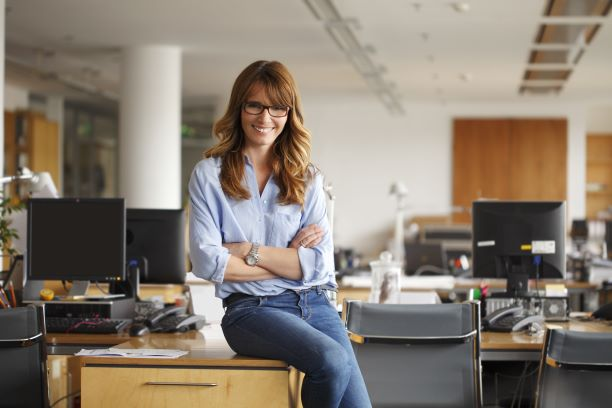 woman sitting on a desk in an office building